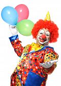 Portrait of a smiling clown with balloons isolated on white