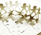 Group of people and jigsaw puzzle pieces