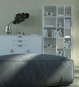 3D Rendering of Modern Living Room Concept - Close up Gray Ottoman in front White Cabinet. with Books and Flower Vase