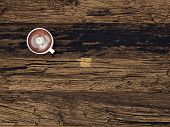 3D Rendering of Overhead view of a mug of freshly brewed coffee or hot chocolate on a wooden desk with wood grain pattern and copyspace