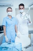 Portrait of male and female dentists wearing surgical masks