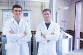 Portrait of scientists with arms crossed in the factory