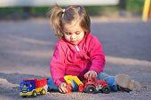 Little Girl Enjoying Time At Playground