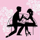 silhouette of lovers sitting on the bench