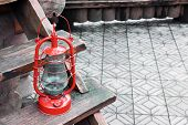 Kerosene lamp on wooden stairs, outdoors