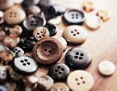 Buttons on a old work table. Shallow depth of field.