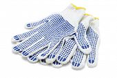 White Cotton Gloves With Blue Rubber Studs On White Background