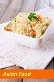 Asian noodles in bowl with vegetables and space for your text