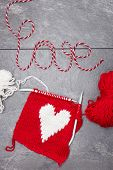 Handmade heart knitted made from yarn with word