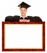 Happy college graduate standing behind frame isolated on white background
