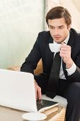 Businessman Having Coffee Break.