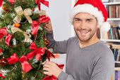 Decorating A Christmas Tree.