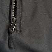 Black Polyester Twill Fabric Texture Background, Open Jacket Zipper Pull Detail, Textured Textile