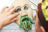 Man Sculpting Plasticine Form Of Face