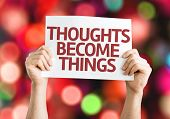 Thoughts Become Things card with colorful background with defocused lights
