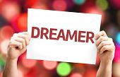 Dreamer card with colorful background with defocused lights