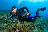 Happy Female SCUBA diver
