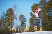 Ecstatic young couple in winterwear spending leisure in park