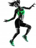one caucasian woman exercising  fitness jumping in studio silhouette isolated on white background