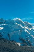 Alpine Alps mountain landscape at St Moritz. Beautiful winter view on sunny day.