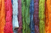 stock photo of silk worm  - Colorful raw silk thread in the silk farm - JPG