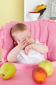 Sleepy Baby In The High Chair