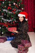 Woman Arrange Xmas Gifts Near Tree