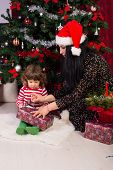 Mother Help Toddler Boy To Open Xmas Gift