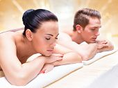 Couple lying on the massage desks on the spa salon. Beauty treatment concept.