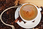 stock photo of coffee crop  - Cup of coffee on saucer and coffee beans - JPG