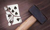 Hammer With A Broken Card, Seven Of Spades
