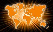 stock photo of starburst  - Map of world with starburst on background orange - JPG