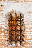 Old fort castle lattice window in brick wall