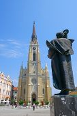 NOVI SAD, SERBIA - AUGUST 02: the Catholic Cathedral and the statue Svetozar Miletic in main square of Novi Sad. Shot in 2014