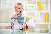 Two-years child himself eats with spoon