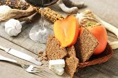 Persimmon, Cereal Bread, Nougat And Red Wine Glass