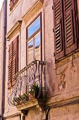Old houses at backstreets of Piran, small coastal town in Istria