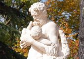 Silenus carrying Dionysus in the arms, antique statue Greek mythology