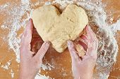 Woman Holding Dough Heart