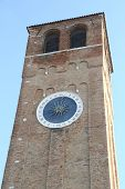 Tower With  Clock With Roman Numerals And A Single Hour Hand