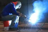 welder is welding steel part