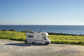 image of caravan  - Caravan on the beach in front of the ocean in Sagres Portugal - JPG