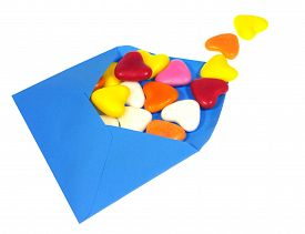 stock photo of laxatives  - A love letter with colorful candy hearts over white - JPG