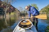 image of horsetooth reservoir  - senior paddler and decked expedition canoe on the shore of Horsetooth Reservoir - JPG