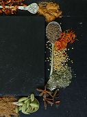 stock photo of saffron  - different spices on a black background  - JPG