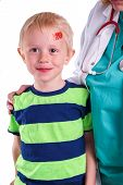 foto of forehead  - Child gets injury on the forehead and the nurse helps with getting plaster on the wound so it can heal - JPG