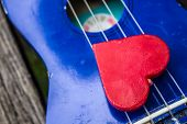picture of heart sounds  - Red heart on the line of guitar - JPG