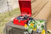picture of nazi  - gramophone with a plate camera and flowers on the table - JPG