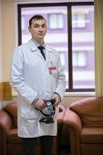 image of infirmary  - male ophthalmologist portrait in hall of a clinic - JPG