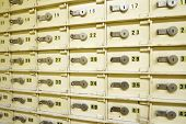 stock photo of bank vault  - Closeup of a group of cells in an old safe bank - JPG